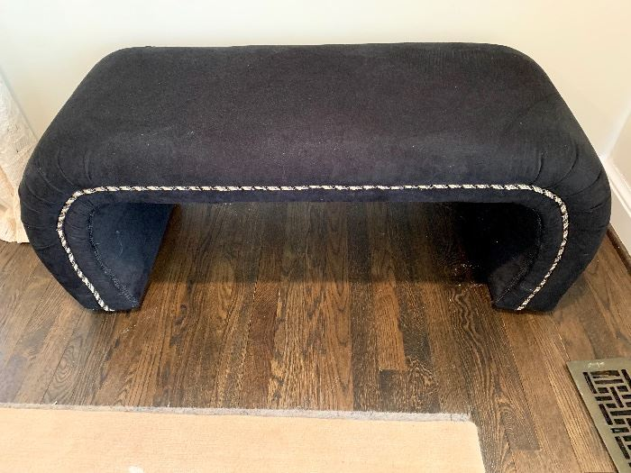 Modern black bench with cording embellishments