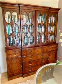 Vintage breakfront/secretary with oval glass