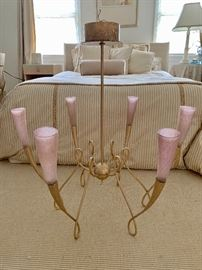 Six arm chandelier with pink  globes.