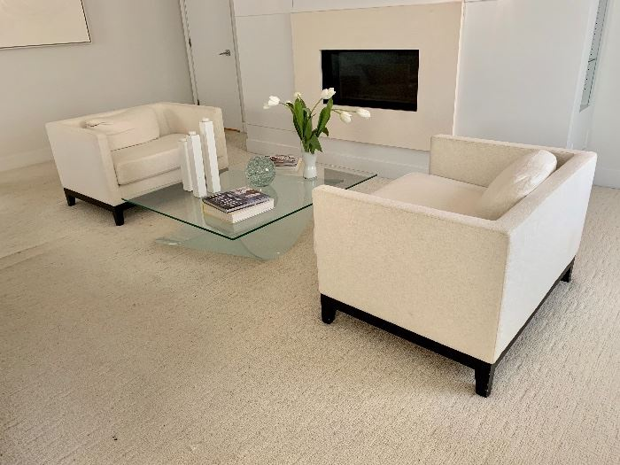 Upholstered chairs by Maurice Villency.  Glass and acrylic coffee table by Roche Bobois.