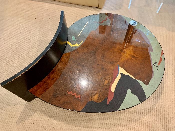 Artistic glass topped coffee table