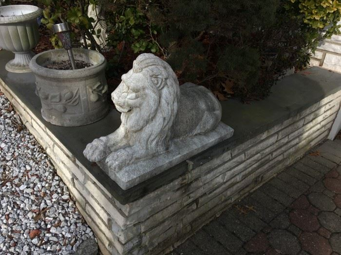Concrete lion, one of a pair in perfect condition