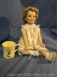 1996 Shirley Temple Doll collection by Elle Hutchens from Danbury mint 11 inches tall. Vintage Orphan Annie Ovaltine mug.