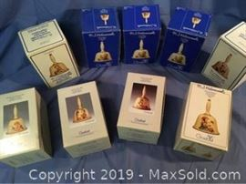 Collectible Hummel Bells in original boxes with paperwork ranging in years 1978 to 1986.