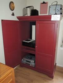 Red painted media cabinet. DVD and cd players.  Brownie projector