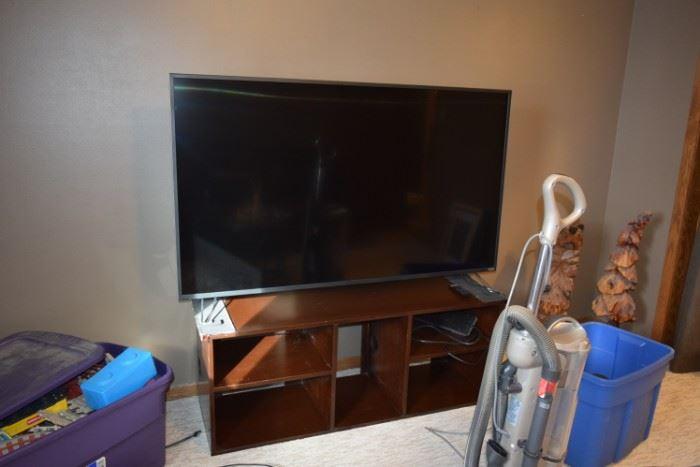 Flat Screen TV, Stand, & Vacuum Cleaner