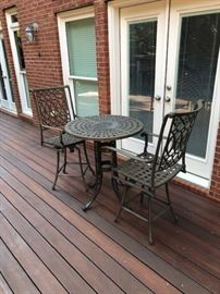 Outdoor iron hightop table and chairs.