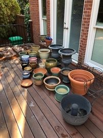 Large collection of eclectic and colorful planters, pots and pottery.