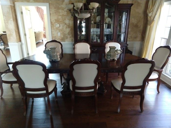 "Wonderful Bernhardt ""La Scala"" double pedestal dining table, measures 46""W, 30""H, 76-112""L, includes 2-18"" leaves + felt pads, 8 chairs (2 arm, 6 side) and matching lighted china cabinet."