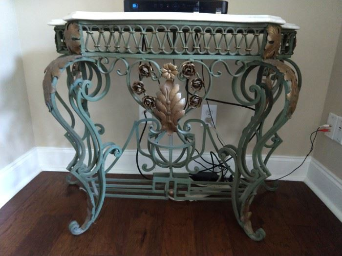 Another of the wonderful wrought iron and marble topped console tables.