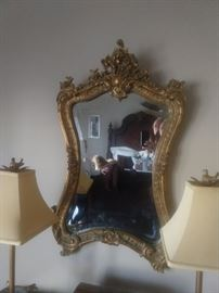 Vintage French gold gilt beveled glass wall mirror.