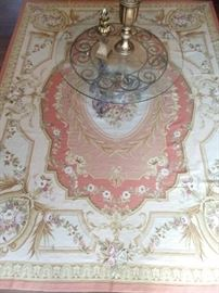 French Aubusson rug, with glass/wrought iron coffee table.