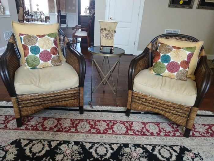 Pair of rattan armchairs, with vintage bronze/black marble side table.