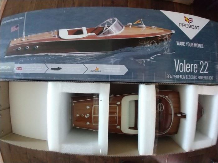 SO - here's something you don't see at the average estate sale. That's because we don't DO average!         NIB Proboat Volere 22 RC 1950's Chris Craft mahogany runabout boat - very cool!