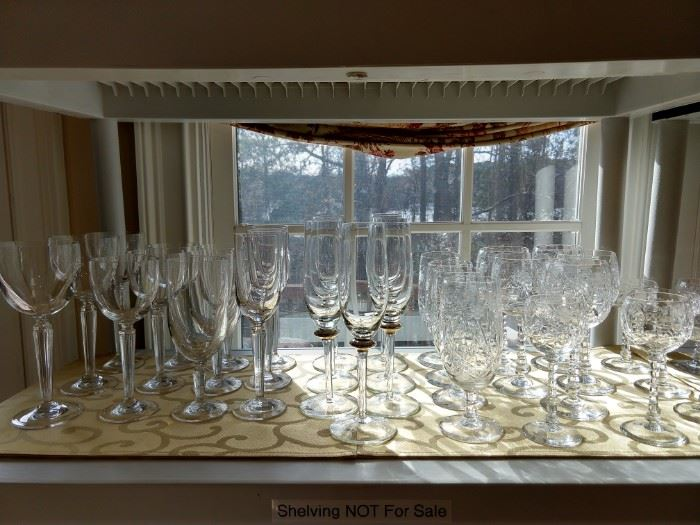Waterford stemware on the left, wheel-cut vintage crystal stemware on the right.