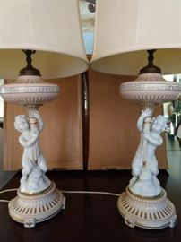 Vintage pair of porcelain RPM (Austria) table lamps, with original shades and finials.