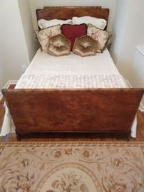 Lovely art deco style burled walnut full size bed, with Yves Delorme linens.