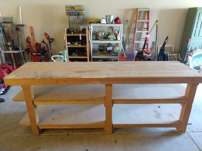 "For the manly man or woman who's good with tools, this thing was in the basement and it took four of us he-men to lug this thing to the garage, so you better buy it! Behemoth dimensions of 8' long x 27"" wide, the solidly constructed 2 x 4 top will take a pounding and never flinch."