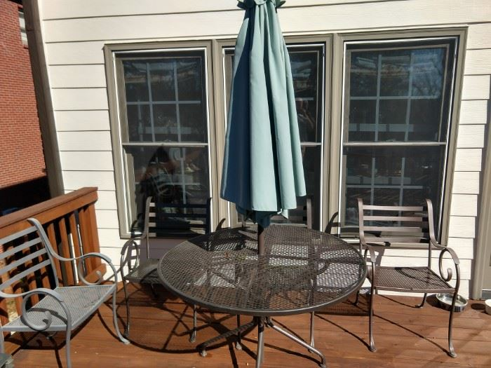 Spring really IS right around the corner and what better way to usher in this pleasant season, than with a round, wrought iron table, 4 chairs and umbrella.                          Buy your own citronella, you're going to need it!