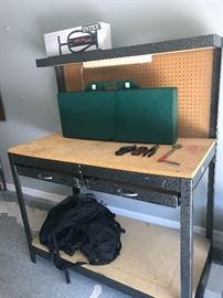 Work bench and folding picnic table.  Also show is a top of the car canvas carrier