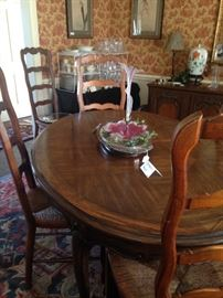 Dining table comfortably seats 6-8 ( has 2 leaves); chairs are sold separate from the table.