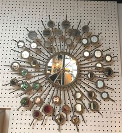 Metal mirrored clock in a mid century modern style