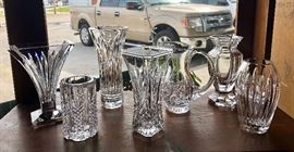 A collection of small WATERFORD crystal vases