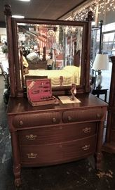 Antique Mahogany Dresser with curved front drawers and beveled mirror that matches antique bed