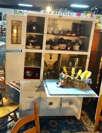 """Vintage (c.1940's) """"HYGENA"""" Hoosier Cabinet, made in Liverpool, UK,  with 4 drawers, 4 doors, the original sifter, and a pull down formica top counter (which is very rare), and this piece even has the original metal tabbed """"grocery reminder"""" mounted on the top door"""