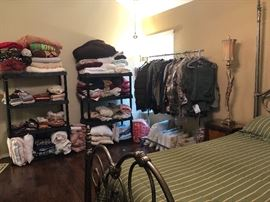 linens  - tons -hunting and shooting shirts-cabelas  size L mostly  queen bed and iron frame