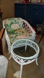 White wicker set includes a coffee table and couch