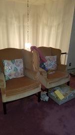 Pair of velvet upholstered wing back chairs