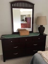 7-drawer Dresser with nickel pulls and attached Mirror from Haverty's