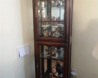 Curio Cabinet (lighted) filled with Hummels.