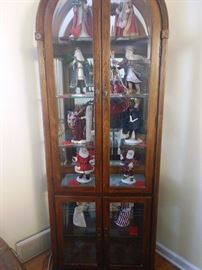 Curio Cabinet with  Duncan Royale Santa Claus collection from 1983.