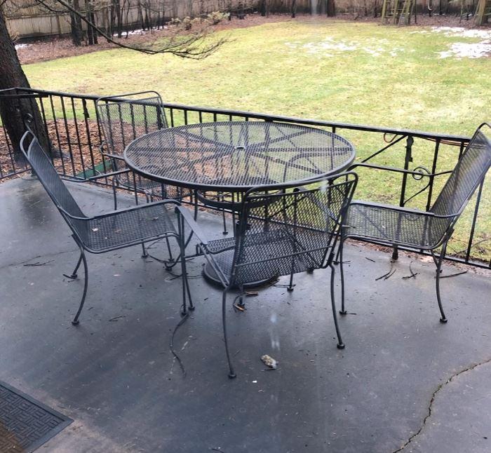 Metal patio set, umbrella no shown.