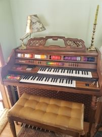 Kimball organ, Broadway model, with bench and sheet music; lamp; candlestick holder.