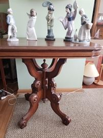 Gorgeous antique parlour table; Lladro figurines