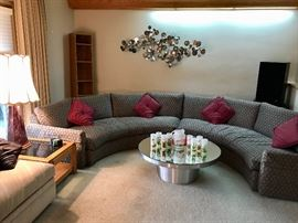 Half-circle couch with round coffee table