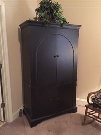 Lovely entertainment cabinet.  Would easily  convert to an extra closet.