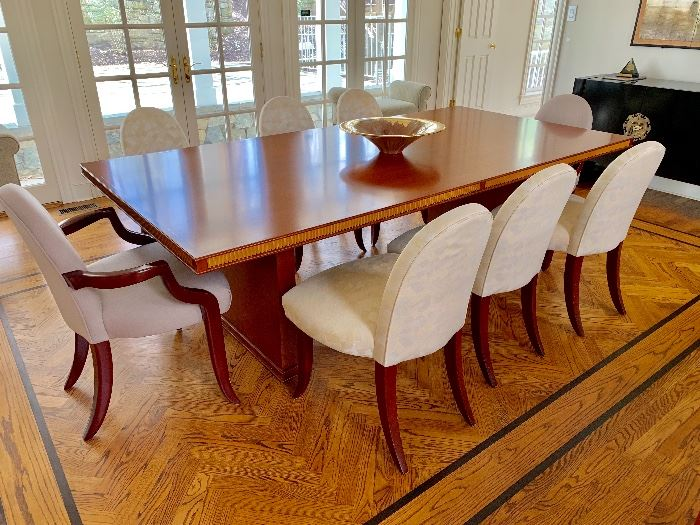 Custom made table designed by Gary Lovejoy.  Six upholstered chairs and 2 upholstered arm chairs