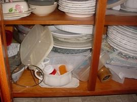 Cabinets and cabinets full and yet to be unpacked...SO MUCH vintage dinnerware