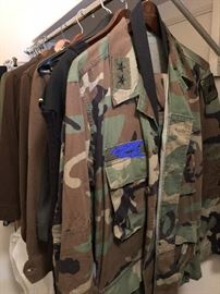A CLOSET FULL OF MILITARY CLOTHING (NAME TAG ERASED FOR PHOTO ONLY)