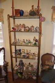 Glass display shelves unit with lots of chachkies