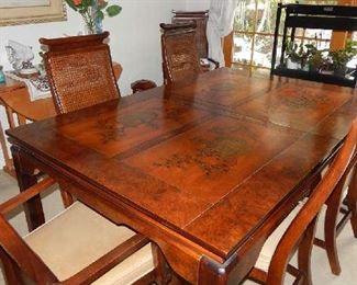 FABULOUS ASIAN STYLE THOMASVILLE DINING TABLE, WITH 2 EXTRA LEAVES UNDERNEATH(SLIDE OUT), 6 CHAIRS(INCLUDES 2 CHAIRS W/ARMS AND CUSTOM MADE TABLE TOPPER. VERY DETAILED TABLE TOP
