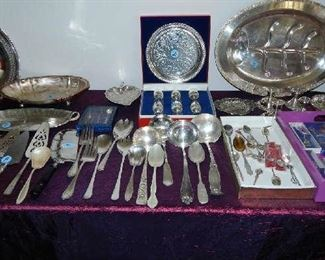 HUGE COLLECTION OF ASSORTED SILVERPLATE PIECES.