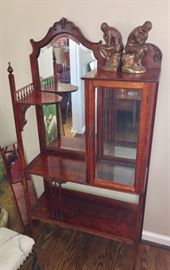 Antique etagere with beveled mirror; inside pane of glass missing on display case