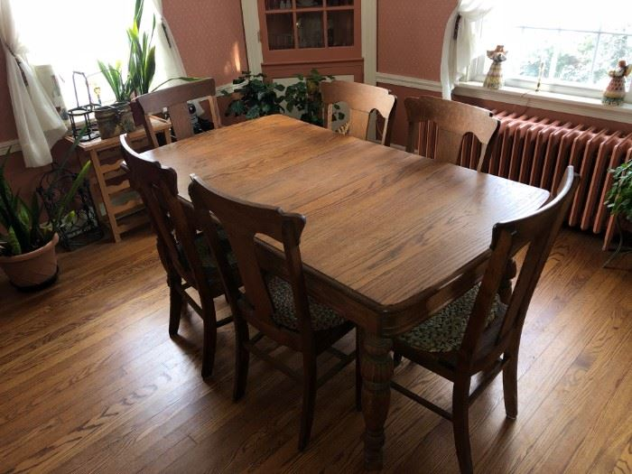 Solid oak table with 6 chairs with caned seats....mint condition