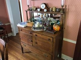Buffet of fantastic quarter oak treatment throughout. Inset mirror original.