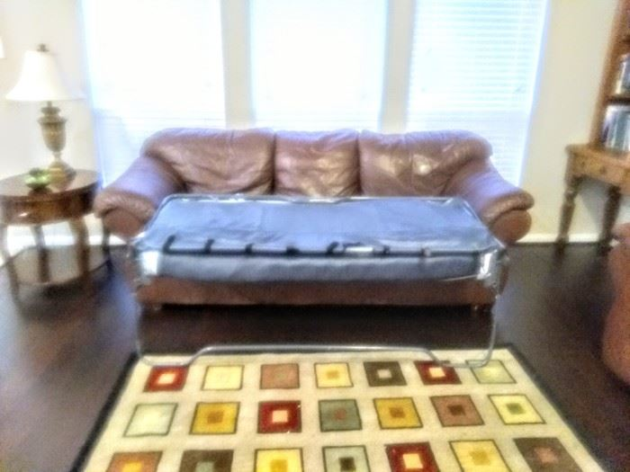 "Matching leather sofa converts to  ""Sleeper Sofa."""